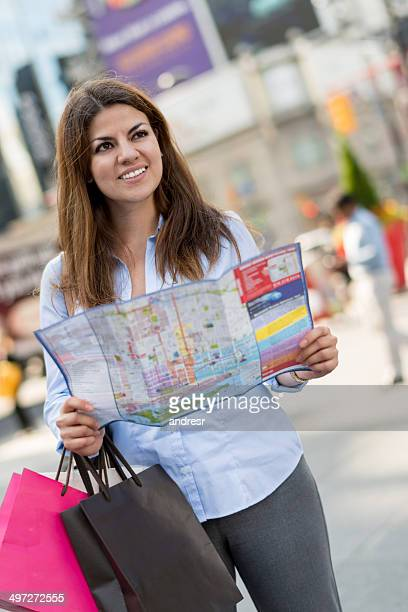 Shopping woman with a map