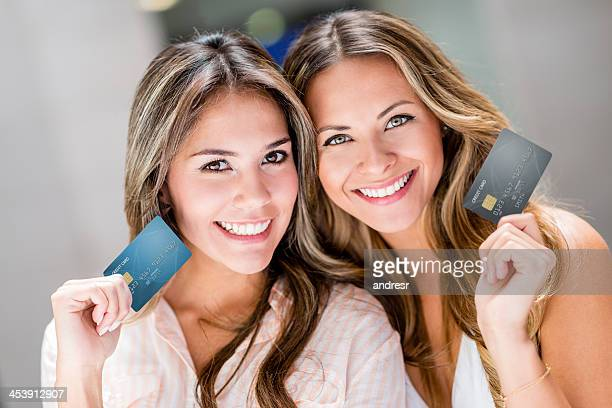 Shopping women holding credit cards
