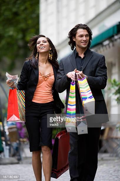 shopping: young affluent couple enjoying a shopping trip