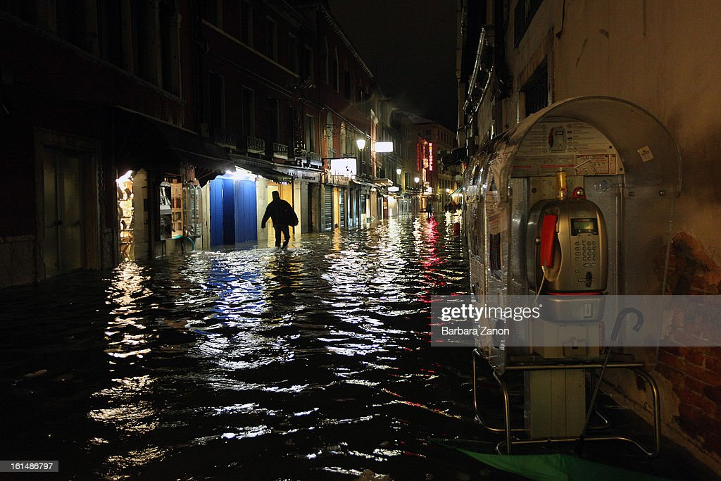 Shops and hotels during a heavy snow and high tide at Lista di Spagna on February 11, 2013 in Venice, Italy. Heavy snow, high water, rain and wind hit the city today and sea level rose to 145cm.
