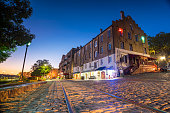Shops and restaurants at River Street in downtown Savannah in Georgia USA