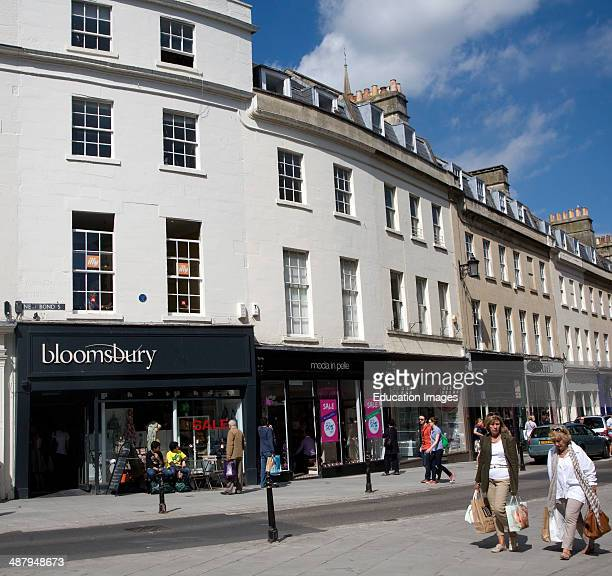 Shops and shoppers in New Bond Street Bath Somerset England