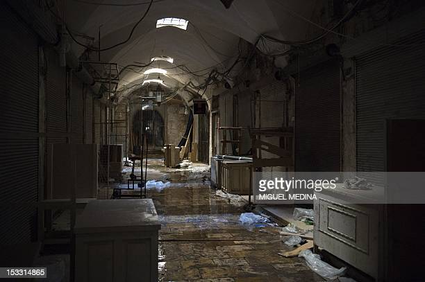 Shops are shuttered in the souk in the old city of Aleppo northern Syria on October 3 as fighting rages on in the city between rebel forces and...