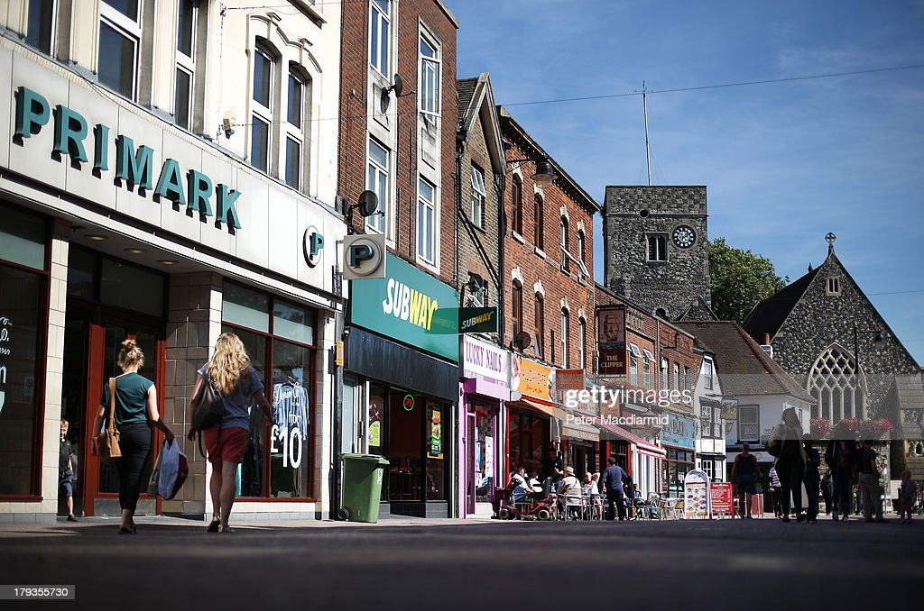 Shops, cafes and a pub on the High Stret on September 2, 2013 in Dartford, England. High Street campaigner Mary Portas is today facing questions from Members of Parliament on the communities and local government select committee. The traditional high street is under increasing pressure due to the recession and the rise of on-line shopping.