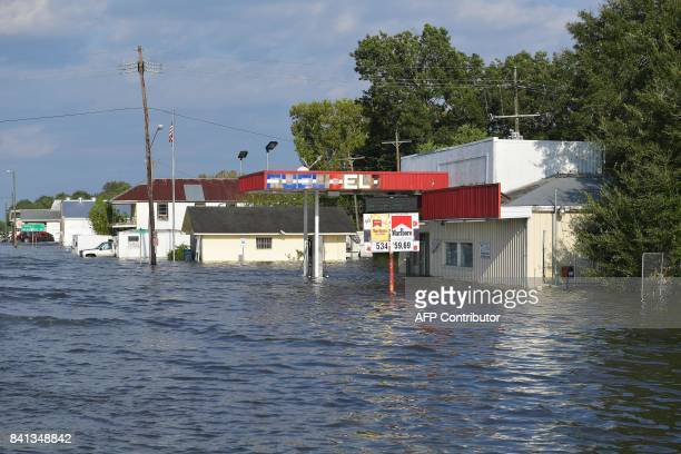 Shops under floodwaters are seen in Nome Texas some 20 miles away from Beaumont Texas on August 31 2017 Residents of the US Gulf Coast states of...