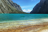 Shore of Llanganuco Orconcocha lake in the Cordillera Blanca in the Andes of Peru.