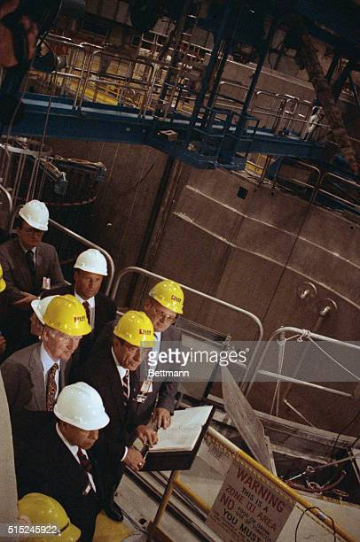 Gov Mario Cuomo gets the lowdown at the Shoreham nuclear plant which seems about to be decommissioned although the $55 billion plant has never gone...