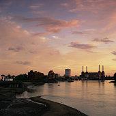Shoreline of Thames river at sunset, Vauxhall, London, England