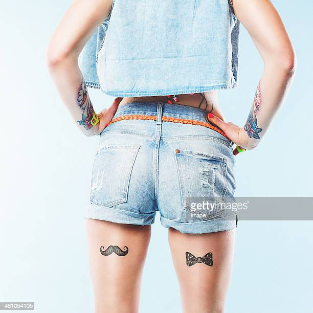 Short jeans shorts and leg tattoos