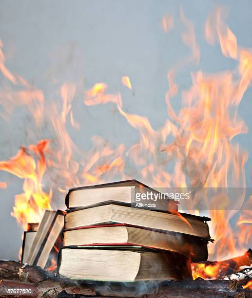 short stack of books ablaze