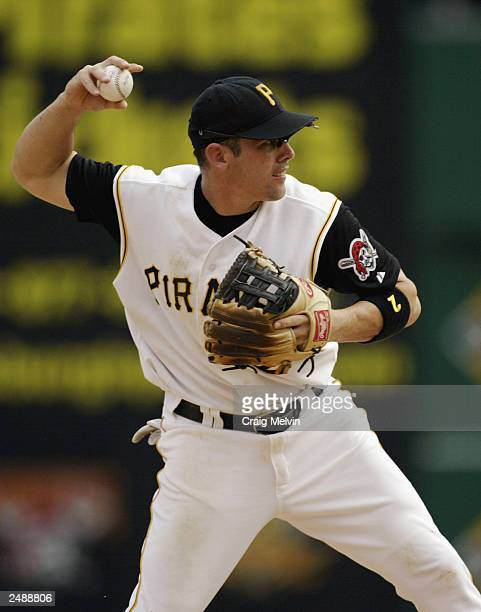 Short stop Jack Wilson of the Pittsburgh Pirates fields the ball during the game against the Atlanta Braves at PNC Park on August 31 2003 in...