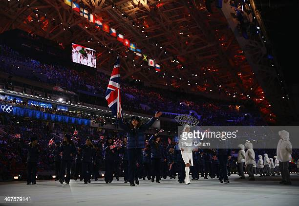 Short track speed skater Jon Eley of the Great Britain Olympic team carries his country's flag during the Opening Ceremony of the Sochi 2014 Winter...