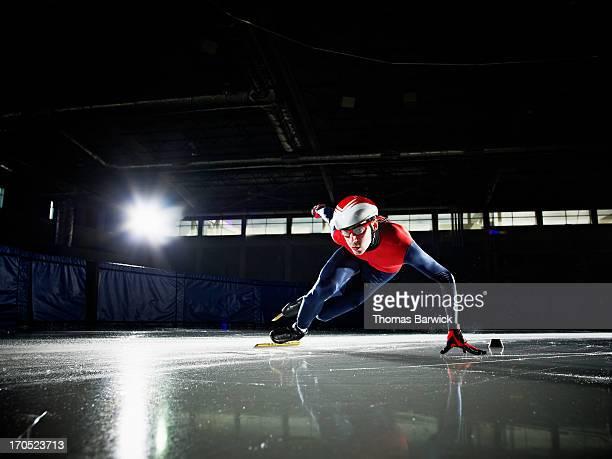 Short track speed skater making turn during race