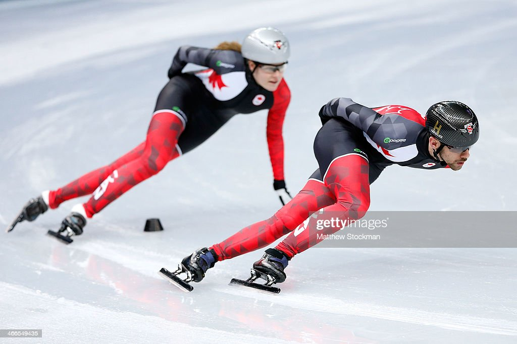 Short Track speed skaters Francois Hamelin and Jessica Gregg of Canada take part in a training session ahead of the Sochi 2014 Winter Olympics at...
