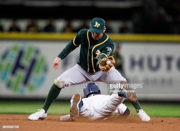 Shortstop Adam Rosales of the Oakland Athletics tags out a stealing Jean Segura of the Seattle Mariners at second base game on a throw by catcher...