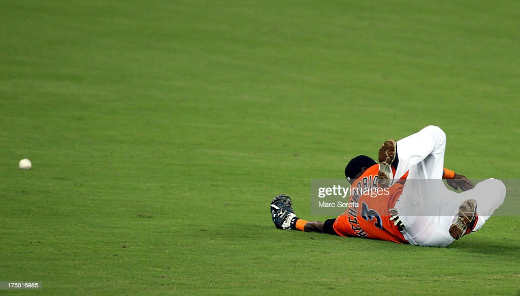 Shortstop Adeiny Hechevarria #3 of the Miami Marlins dives for a ball against the New York Mets at Marlins Park on July 29, 2013 in Miami, Florida.