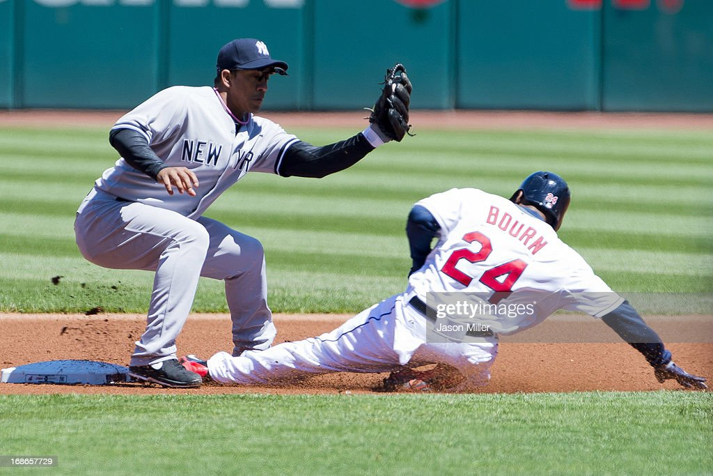 Shortstop Alberto Gonzalez #40 of the New York Yankees catches <a gi-track='captionPersonalityLinkClicked' href=/galleries/search?phrase=Michael+Bourn&family=editorial&specificpeople=835742 ng-click='$event.stopPropagation()'>Michael Bourn</a> #24 of the Cleveland Indians stealing second during the first inning during the first game of a doubleheader at Progressive Field on May 13, 2013 in Cleveland, Ohio.