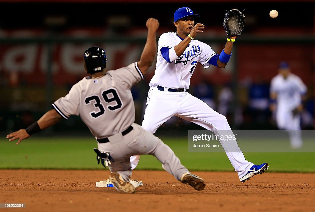 Shortstop <a gi-track='captionPersonalityLinkClicked' href=/galleries/search?phrase=Alcides+Escobar&family=editorial&specificpeople=4845889 ng-click='$event.stopPropagation()'>Alcides Escobar</a> #2 of the Kansas City Royals fields a double play ball as Chris Nelson #39 of the New York Yankees slides into second during the game at Kauffman Stadium on May 10, 2013 in Kansas City, Missouri.