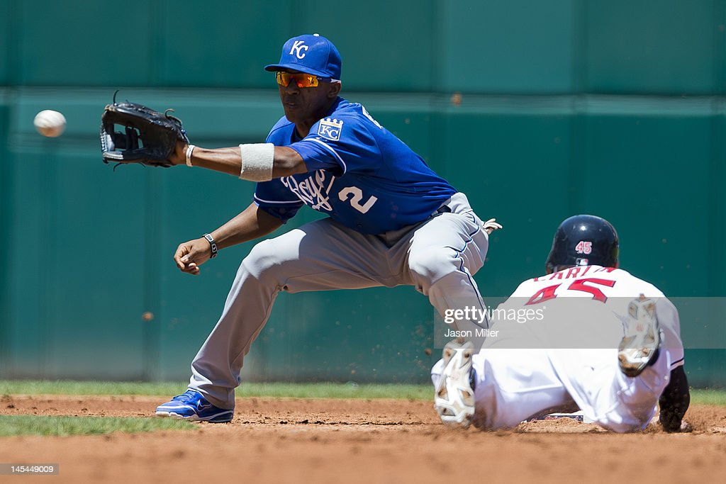 Shortstop Alcides Escobar #2 of the Kansas City Royals is un able to tag Luke Carlin #45 of the Cleveland Indians in time as he steals second base during the second inning at Progressive Field on May 30, 2012 in Cleveland, Ohio.