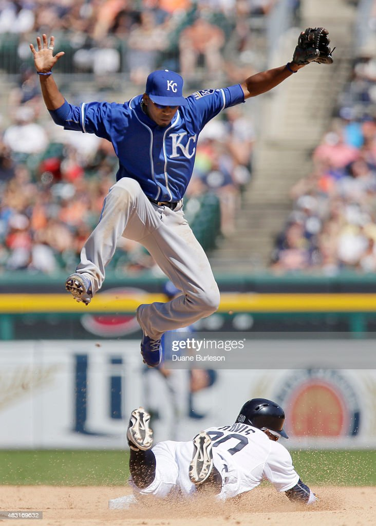 Shortstop <a gi-track='captionPersonalityLinkClicked' href=/galleries/search?phrase=Alcides+Escobar&family=editorial&specificpeople=4845889 ng-click='$event.stopPropagation()'>Alcides Escobar</a> #2 of the Kansas City Royals jumps out of the way of <a gi-track='captionPersonalityLinkClicked' href=/galleries/search?phrase=Rajai+Davis&family=editorial&specificpeople=810608 ng-click='$event.stopPropagation()'>Rajai Davis</a> #20 of the Detroit Tigers stealing second base when the pickoff throw was wide of the base during the eighth inning at Comerica Park on August 6, 2015 in Detroit, Michigan. The throw went into center field as Davis advanced to third base.