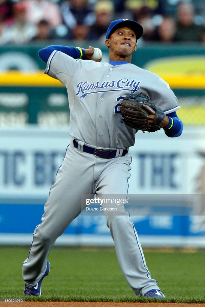 Shortstop <a gi-track='captionPersonalityLinkClicked' href=/galleries/search?phrase=Alcides+Escobar&family=editorial&specificpeople=4845889 ng-click='$event.stopPropagation()'>Alcides Escobar</a> #2 of the Kansas City Royals throws out Torii Hunter #48 of the Detroit Tigers at first base in the first inning at Comerica Park on September 13, 2013 in Detroit, Michigan.