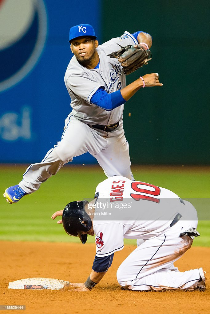 Shortstop <a gi-track='captionPersonalityLinkClicked' href=/galleries/search?phrase=Alcides+Escobar&family=editorial&specificpeople=4845889 ng-click='$event.stopPropagation()'>Alcides Escobar</a> #2 of the Kansas City Royals throws to first as <a gi-track='captionPersonalityLinkClicked' href=/galleries/search?phrase=Yan+Gomes&family=editorial&specificpeople=9004037 ng-click='$event.stopPropagation()'>Yan Gomes</a> #10 of the Cleveland Indians is out at second during the fifth inning at Progressive Field on September 17, 2015 in Cleveland, Ohio.