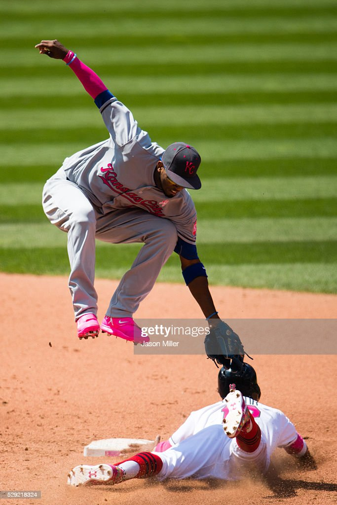 Shortstop Alcides Escobar of the Kansas City Royals tries to tag Francisco Lindor of the Cleveland Indians as he steals second during the fifth...