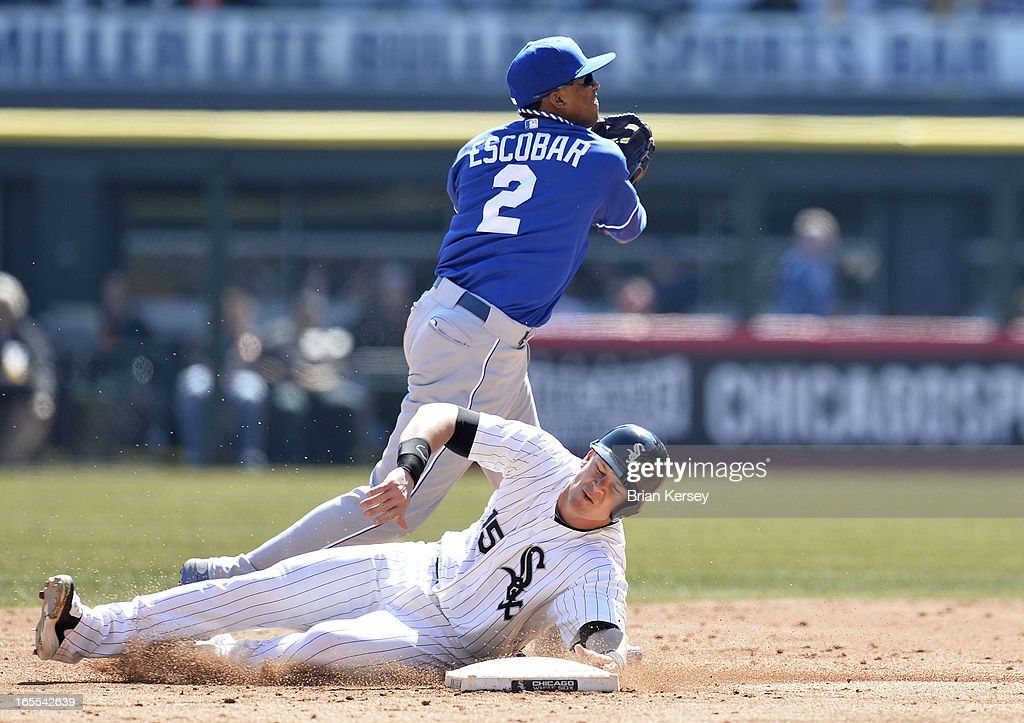 Shortstop <a gi-track='captionPersonalityLinkClicked' href=/galleries/search?phrase=Alcides+Escobar&family=editorial&specificpeople=4845889 ng-click='$event.stopPropagation()'>Alcides Escobar</a> #2 of the Kansas City Royals turns a double play past <a gi-track='captionPersonalityLinkClicked' href=/galleries/search?phrase=Gordon+Beckham&family=editorial&specificpeople=5411079 ng-click='$event.stopPropagation()'>Gordon Beckham</a> #15 of the Chicago White Sox on a ground ball hit by Alejandro De Aza #30 slides into second base during the third inning on April 4, 2012 at U.S. Cellular Field in Chicago, Illinois. The Royals defeated the White Sox 3-1.