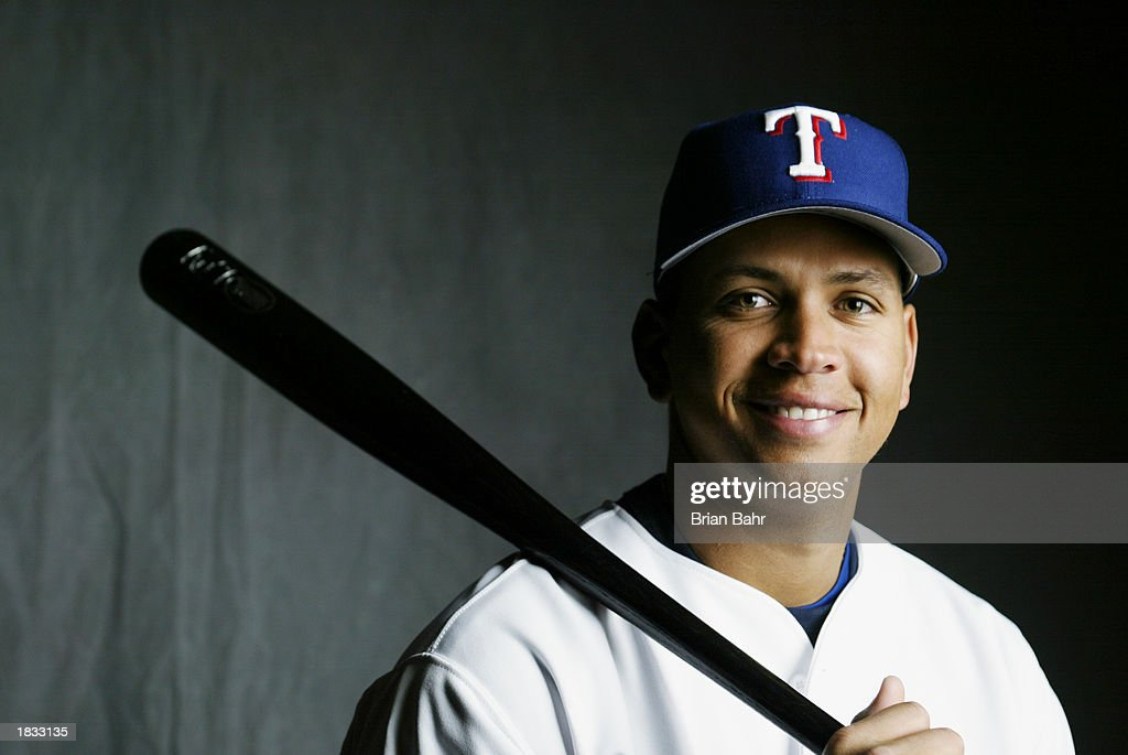 Shortstop <a gi-track='captionPersonalityLinkClicked' href=/galleries/search?phrase=Alex+Rodriguez+-+Baseball+Player&family=editorial&specificpeople=167080 ng-click='$event.stopPropagation()'>Alex Rodriguez</a> #3 of the Texas Rangers smiles during spring training media day February 26, 2003, in Surprise, Arizona.