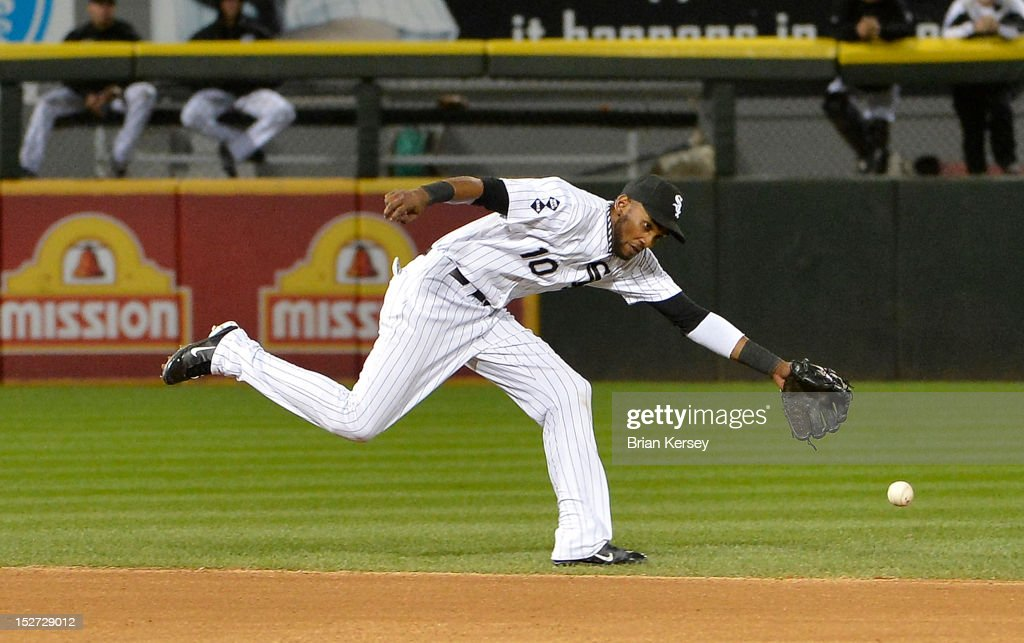 Shortstop <a gi-track='captionPersonalityLinkClicked' href=/galleries/search?phrase=Alexei+Ramirez&family=editorial&specificpeople=690568 ng-click='$event.stopPropagation()'>Alexei Ramirez</a> #10 of the Chicago White Sox cannot get to a single hit by Carlos Santana #41 of the Cleveland Indians during the sixth inning at U.S. Cellular Field on September 24, 2012 in Chicago, Illinois.