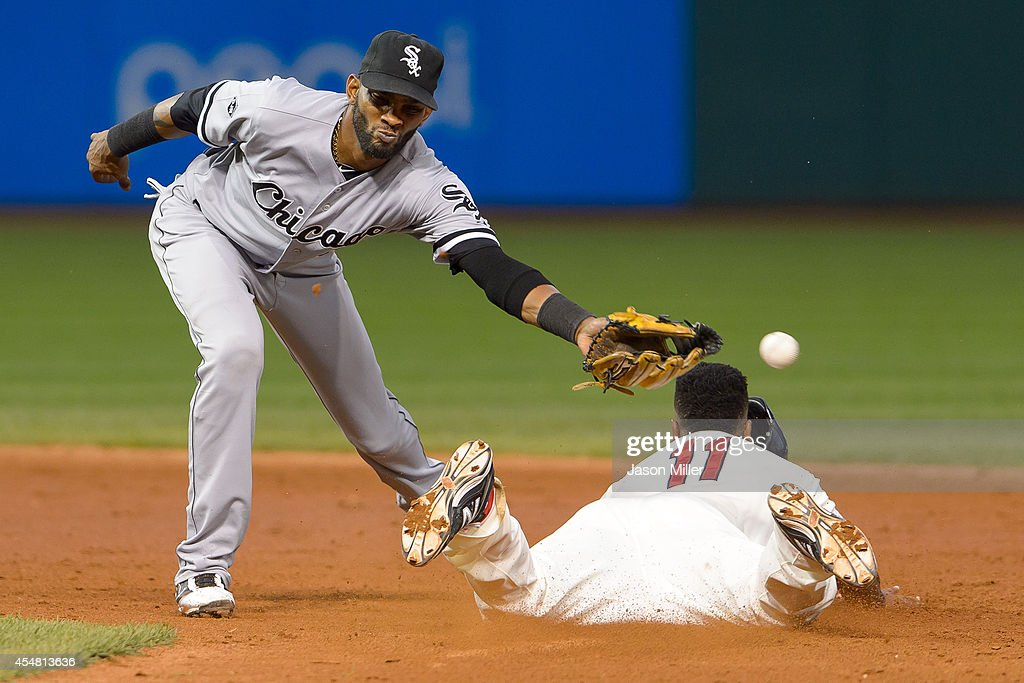Shortstop Alexei Ramirez #10 of the Chicago White Sox drops the throw as Jose Ramirez #11 of the Cleveland Indians steals second during the third inning at Progressive Field on September 6, 2014 in Cleveland, Ohio.