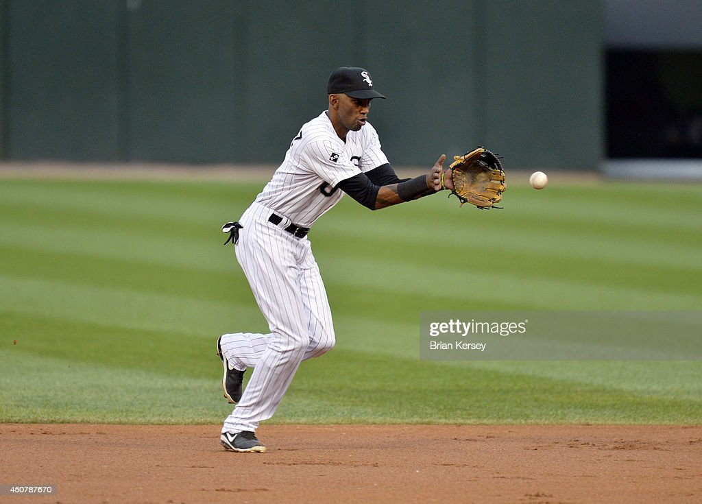 Shortstop <a gi-track='captionPersonalityLinkClicked' href=/galleries/search?phrase=Alexei+Ramirez&family=editorial&specificpeople=690568 ng-click='$event.stopPropagation()'>Alexei Ramirez</a> #10 of the Chicago White Sox fields a ground ball during the second inning against the San Francisco Giants at U.S. Cellular Field on June 17, 2014 in Chicago, Illinois.