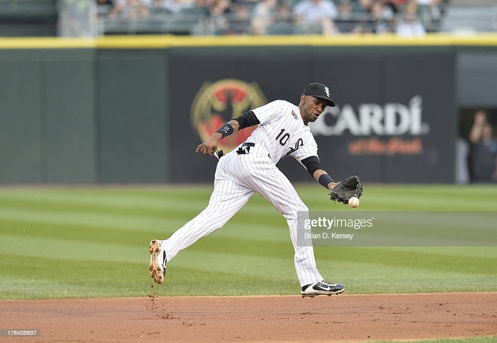 Shortstop Alexei Ramirez #10 of the Chicago White Sox flips the ball with his glove against the Texas Rangers during the 2013 Civil Rights Game at U.S. Cellular Field on August 24, 2013 in Chicago, Illinois. The White Sox won 3-2.