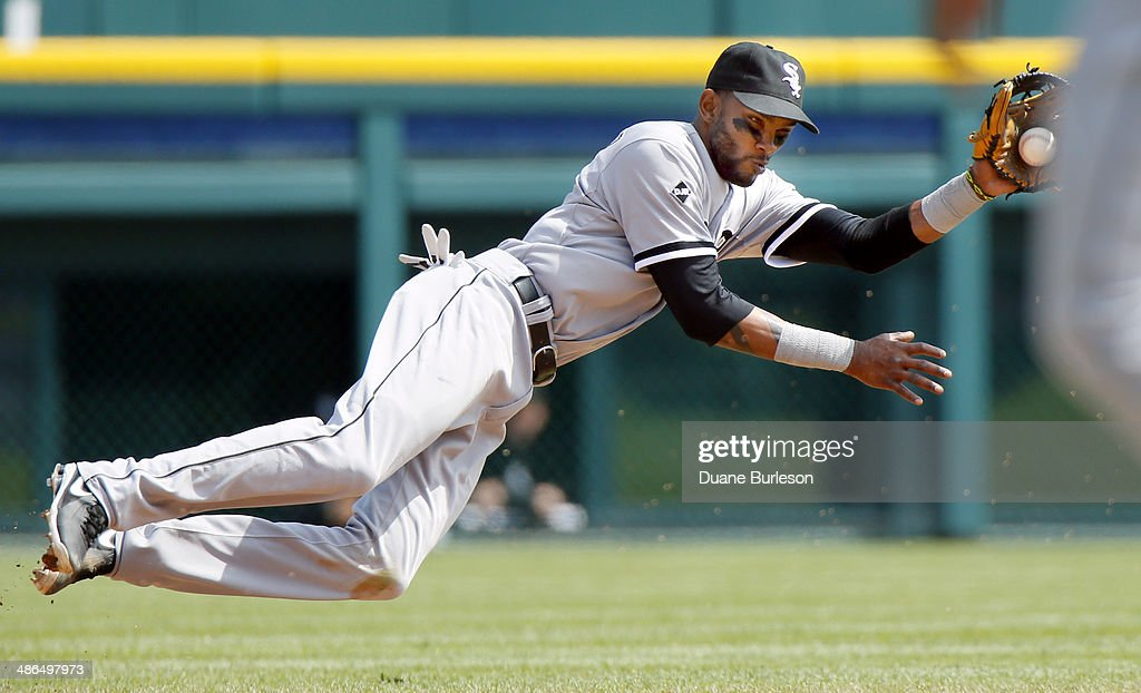 Shortstop <a gi-track='captionPersonalityLinkClicked' href=/galleries/search?phrase=Alexei+Ramirez&family=editorial&specificpeople=690568 ng-click='$event.stopPropagation()'>Alexei Ramirez</a> #10 of the Chicago White Sox makes a diving stop on a grounder hit by Ian Kinsler #3 of the Detroit Tigers and throws him out at first base in the fifth inning at Comerica Park on April 24, 2014 in Detroit, Michigan.