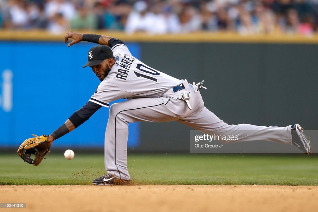 Shortstop <a gi-track='captionPersonalityLinkClicked' href=/galleries/search?phrase=Alexei+Ramirez&family=editorial&specificpeople=690568 ng-click='$event.stopPropagation()'>Alexei Ramirez</a> #10 of the Chicago White Sox reaches for a single off the bat of Mike Zunino of the Seattle Mariners in the seventh inning at Safeco Field on August 9, 2014 in Seattle, Washington.
