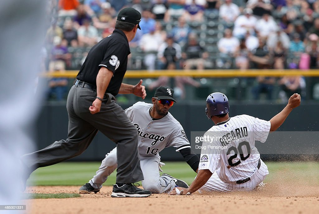 Shortstop <a gi-track='captionPersonalityLinkClicked' href=/galleries/search?phrase=Alexei+Ramirez&family=editorial&specificpeople=690568 ng-click='$event.stopPropagation()'>Alexei Ramirez</a> #10 of the Chicago White Sox tages out <a gi-track='captionPersonalityLinkClicked' href=/galleries/search?phrase=Wilin+Rosario&family=editorial&specificpeople=5734314 ng-click='$event.stopPropagation()'>Wilin Rosario</a> #20 of the Colorado Rockies as second base umpire umpire <a gi-track='captionPersonalityLinkClicked' href=/galleries/search?phrase=Rob+Drake&family=editorial&specificpeople=247242 ng-click='$event.stopPropagation()'>Rob Drake</a> oversees the action during Interleague play at Coors Field on April 9, 2014 in Denver, Colorado. The Rockies defeated the White Sox 10-4.