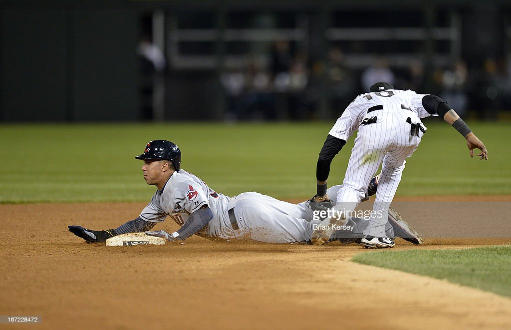 Shortstop <a gi-track='captionPersonalityLinkClicked' href=/galleries/search?phrase=Alexei+Ramirez&family=editorial&specificpeople=690568 ng-click='$event.stopPropagation()'>Alexei Ramirez</a> #10 of the Chicago White Sox (R) tags out Michael Brantley #23 of the Cleveland Indians as he tries to steal second base during the fifth inning on April 22, 2012 at U.S. Cellular Field in Chicago, Illinois.