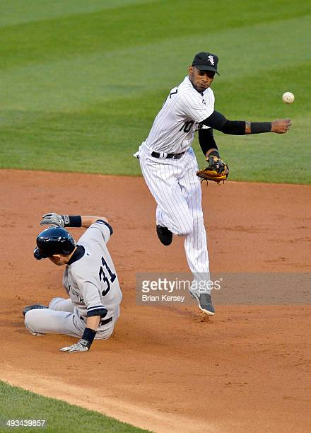 Shortstop Alexei Ramirez of the Chicago White Sox turns a double play after forcing out Ichiro Suzuki of the New York Yankees at second base on a...