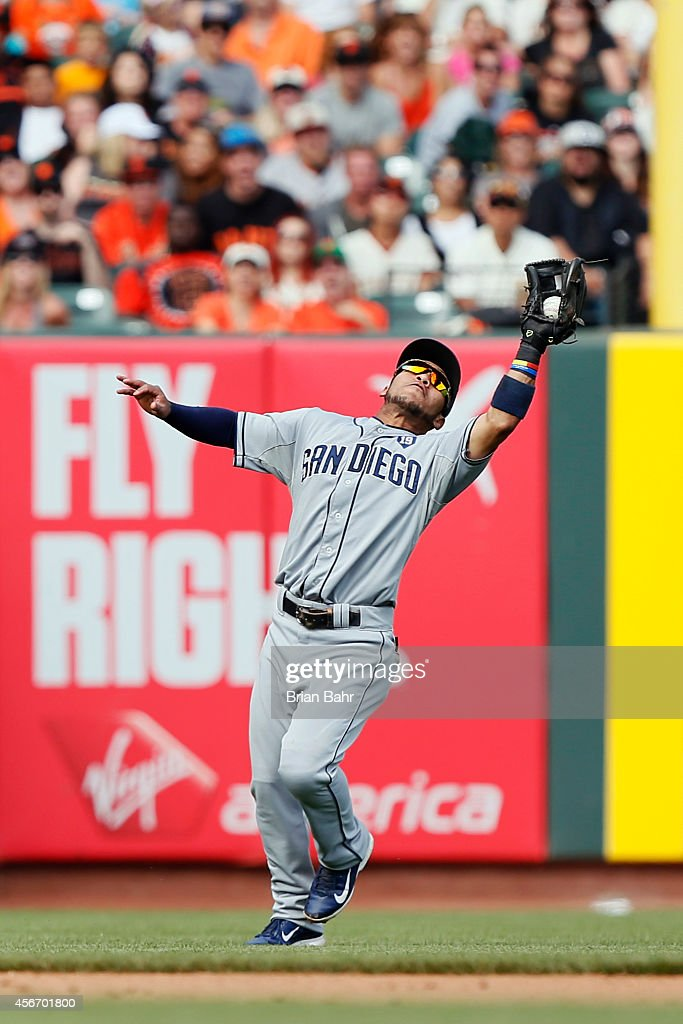 Shortstop Alexi Amarista of the San Diego Padres catches a popup by Brandon Crawford of the San Francisco Giants in the seventh inning at ATT Park on...
