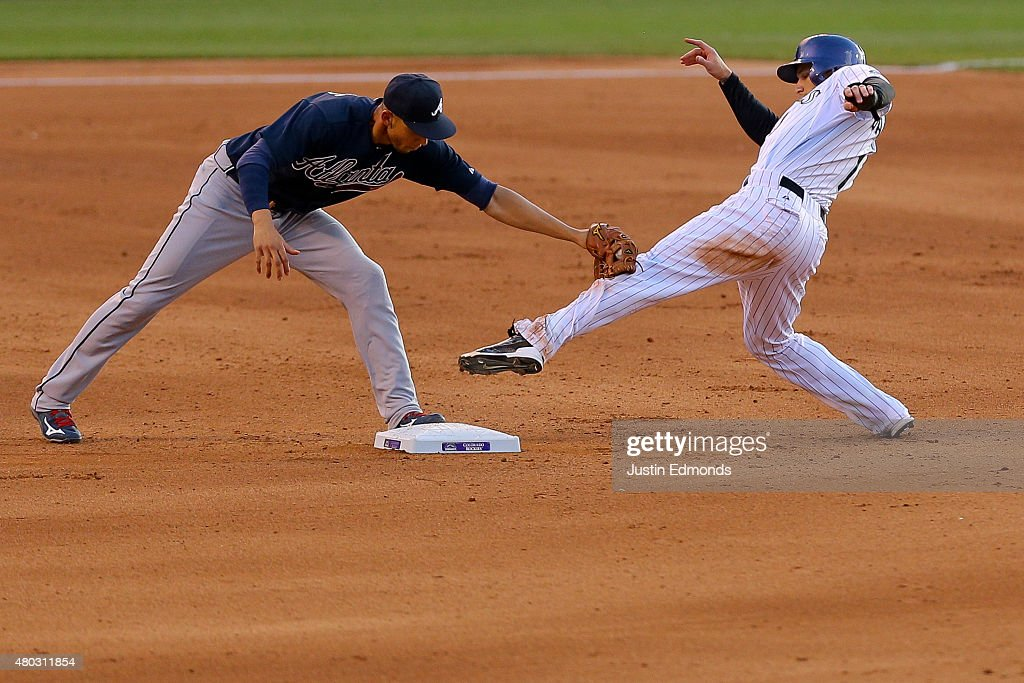Shortstop <a gi-track='captionPersonalityLinkClicked' href=/galleries/search?phrase=Andrelton+Simmons&family=editorial&specificpeople=8978424 ng-click='$event.stopPropagation()'>Andrelton Simmons</a> #19 of the Atlanta Braves applies the tag to <a gi-track='captionPersonalityLinkClicked' href=/galleries/search?phrase=Brandon+Barnes+-+Baseball+Player&family=editorial&specificpeople=10139949 ng-click='$event.stopPropagation()'>Brandon Barnes</a> #1 of the Colorado Rockies after Barnes was unable to keep his foot on the bag after safely stealing second during the fourth inning at Coors Field on July 10, 2015 in Denver, Colorado.