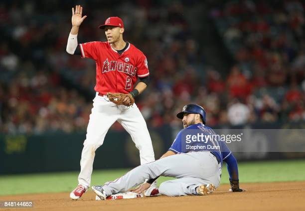 Shortstop Andrelton Simmons of the Los Angeles Angels of Anaheim signals to his dugout after Joey Gallo of the Texas Rangers was called safe...