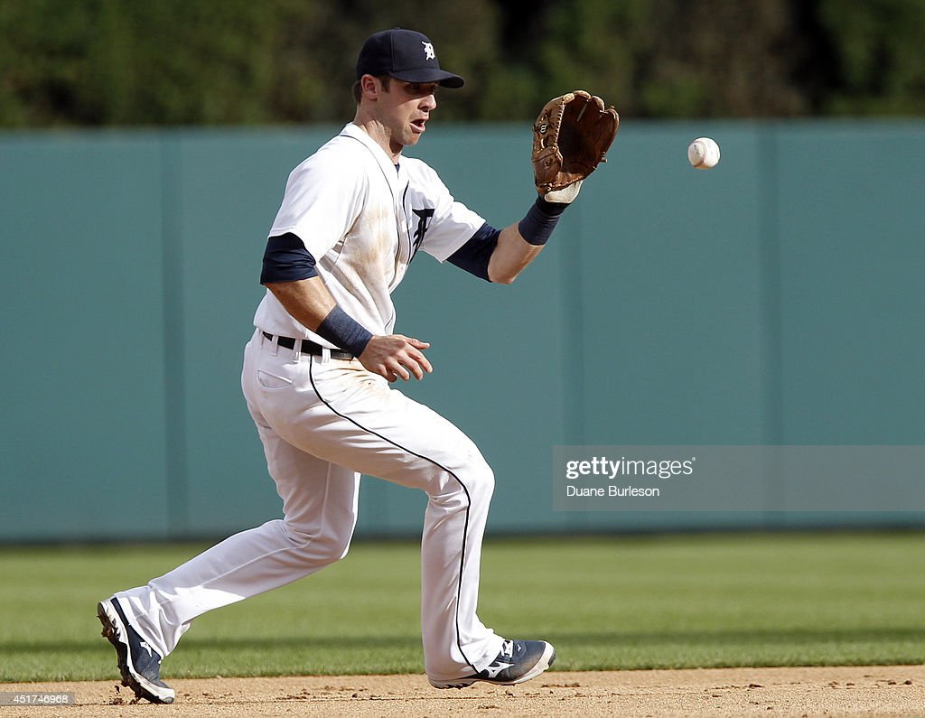 Shortstop Andrew Romine #27 of the Detroit Tigers fields a grounder hit by Ryan Hanigan #24 of the Tampa Bay Rays and flips it to second baseman Ian Kinsler to begin a double play during the eighth inning at Comerica Park on July 5, 2014 in Detroit, Michigan.