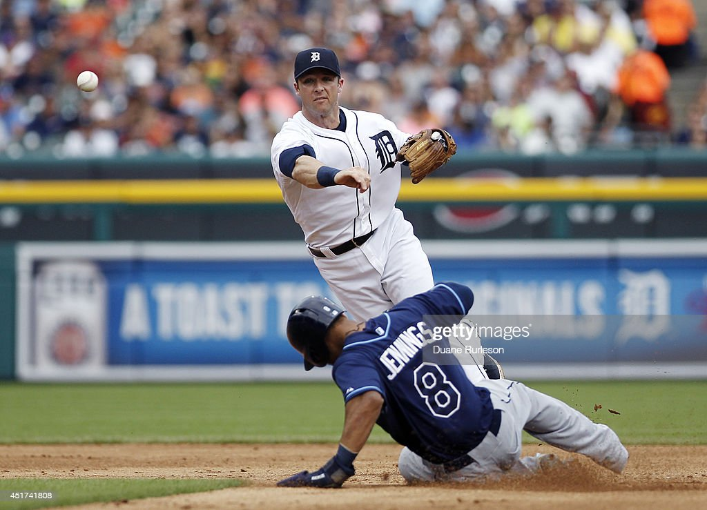 Shortstop <a gi-track='captionPersonalityLinkClicked' href=/galleries/search?phrase=Andrew+Romine&family=editorial&specificpeople=2338123 ng-click='$event.stopPropagation()'>Andrew Romine</a> #27 of the Detroit Tigers turns the ball for a double play after getting a force out on <a gi-track='captionPersonalityLinkClicked' href=/galleries/search?phrase=Desmond+Jennings&family=editorial&specificpeople=5974085 ng-click='$event.stopPropagation()'>Desmond Jennings</a> #8 of the Tampa Bay Rays during the fifth inning at Comerica Park on July 5, 2014 in Detroit, Michigan. Ben Zobrist hit into the play and was out at first base.