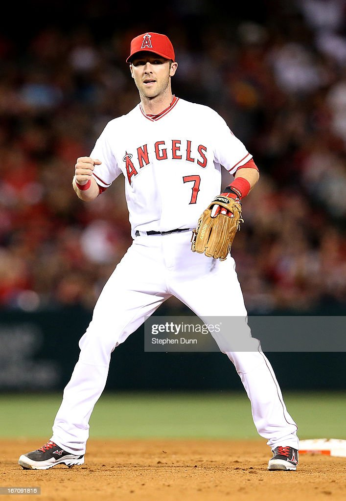 Shortstop Andrew Romine #7 of the Los Angeles Angels of Anaheim pumps his fist after turning an inning ending double play against the Detroit Tigers in the seventh inning at Angel Stadium of Anaheim on April 19, 2013 in Anaheim, California.