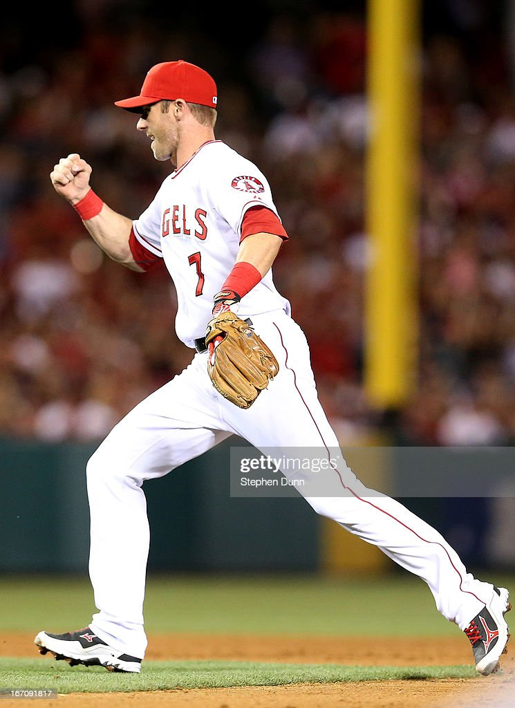 Shortstop <a gi-track='captionPersonalityLinkClicked' href=/galleries/search?phrase=Andrew+Romine&family=editorial&specificpeople=2338123 ng-click='$event.stopPropagation()'>Andrew Romine</a> #7 of the Los Angeles Angels of Anaheim pumps his fist after turning an inning ending double play against the Detroit Tigers in the seventh inning at Angel Stadium of Anaheim on April 19, 2013 in Anaheim, California.