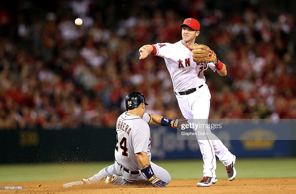 Shortstop <a gi-track='captionPersonalityLinkClicked' href=/galleries/search?phrase=Andrew+Romine&family=editorial&specificpeople=2338123 ng-click='$event.stopPropagation()'>Andrew Romine</a> #7 of the Los Angeles Angels of Anaheim throws to first after forcing out <a gi-track='captionPersonalityLinkClicked' href=/galleries/search?phrase=Miguel+Cabrera&family=editorial&specificpeople=202141 ng-click='$event.stopPropagation()'>Miguel Cabrera</a> #24 of the Detroit Tigers to complete a double play ending the seventth inning at Angel Stadium of Anaheim on April 19, 2013 in Anaheim, California.