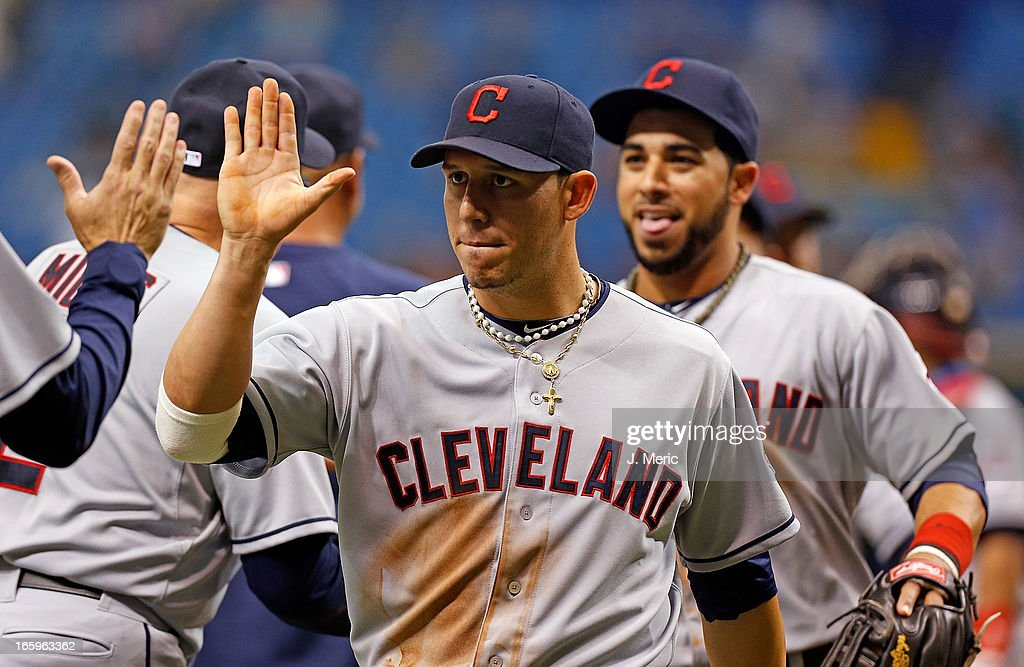 Shortstop <a gi-track='captionPersonalityLinkClicked' href=/galleries/search?phrase=Asdrubal+Cabrera&family=editorial&specificpeople=834042 ng-click='$event.stopPropagation()'>Asdrubal Cabrera</a> #13 of the Cleveland Indians celebrates the Indians victory over the Tampa Bay Rays at Tropicana Field on April 7, 2013 in St. Petersburg, Florida.