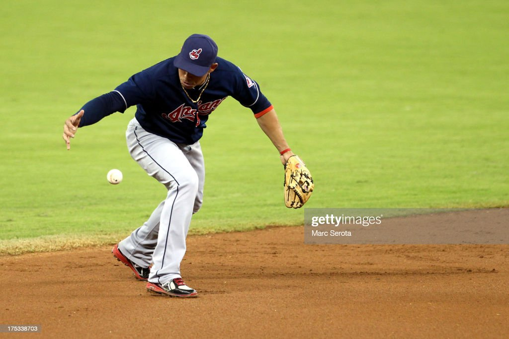 Shortstop Asdrubal Cabrera #13 of the Cleveland Indians commits an error during the first inning against the Miami Marlins at Marlins Park on August 2, 2013 in Miami, Florida.