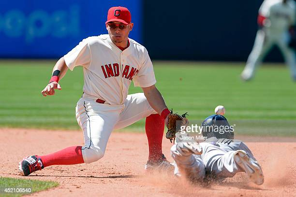 Shortstop Asdrubal Cabrera of the Cleveland Indians fails to catch the throw from home as Leury Garcia of the Chicago White Sox steals second during...