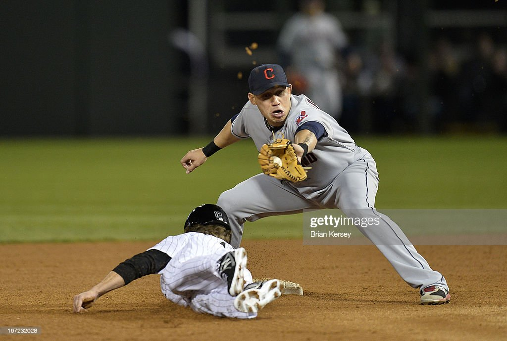 Shortstop Asdrubal Cabrera #13 of the Cleveland Indians tags out Blake Tekotte #18 of the Chicago White Sox at second base on a pickoff play during the seventh inning on April 22, 2012 at U.S. Cellular Field in Chicago, Illinois.